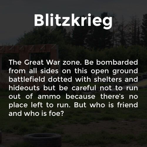 A fun description of the Blitzkrieg paintball arena with wooden obstacles, tyre and trenches in the background.