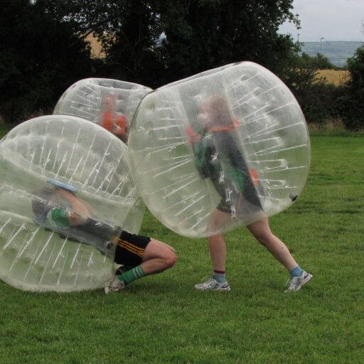 Two players tackle in Bubble Soccer while a third looks on at the Kilkenny Activity Centre.