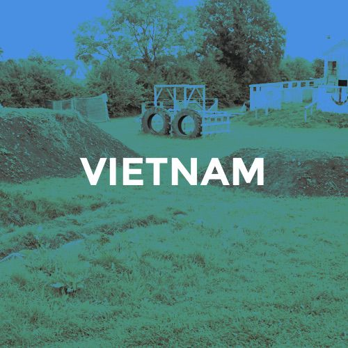 A paintball arena consisting of obstacles and trenches with the caption Vietnam to the foreground.