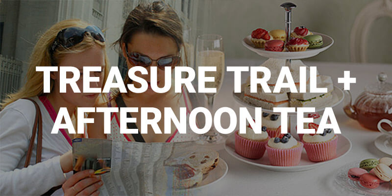 Hen Parties Kilkenny Banner ad for the Kilkenny Treasure Trail and Afternoon tea with an image of two ladies studying clues beside a selection of afternoon tea goodies.