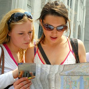 Two young ladies studying clues while trying to complete the Kilkenny Activity Centre Treasure Trail.