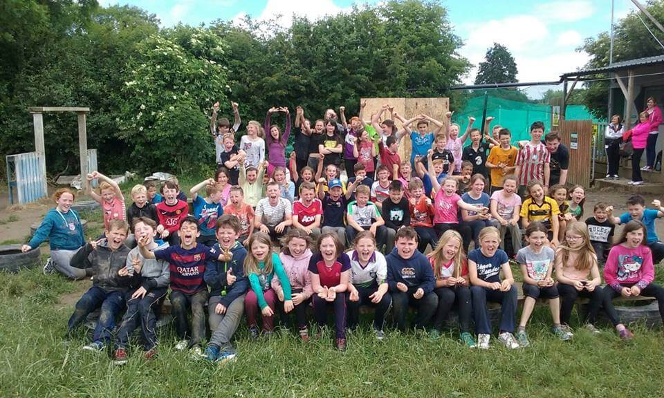 A happy school tour group posing for activities after taking part in school tour activities in Kilkenny.