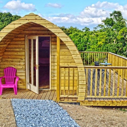 Glamping pod in Kilkenny with decking set in woodland.
