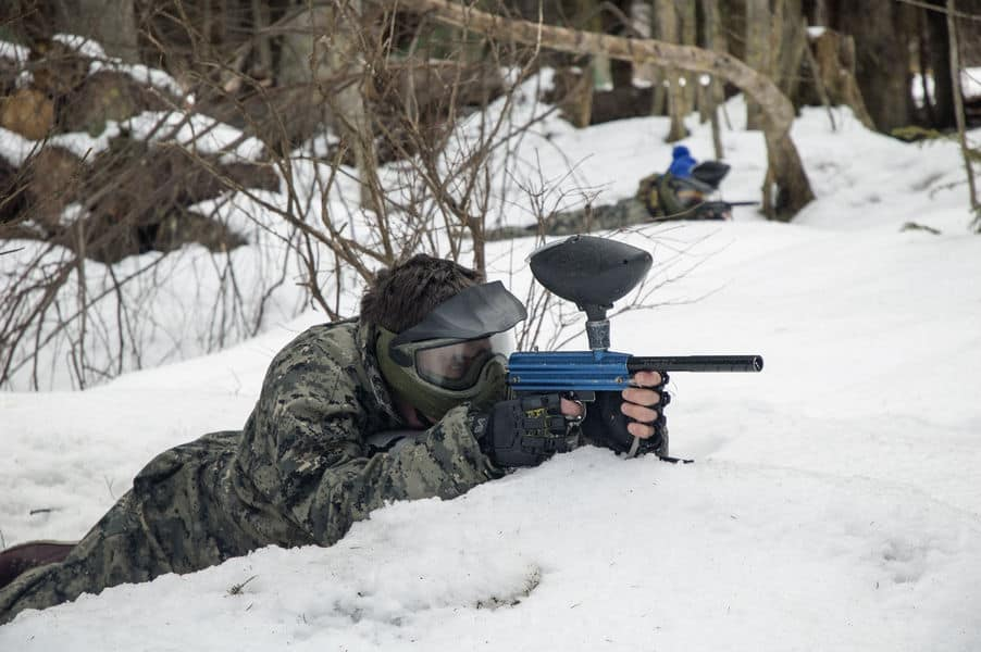 Man playing paintball in the snow