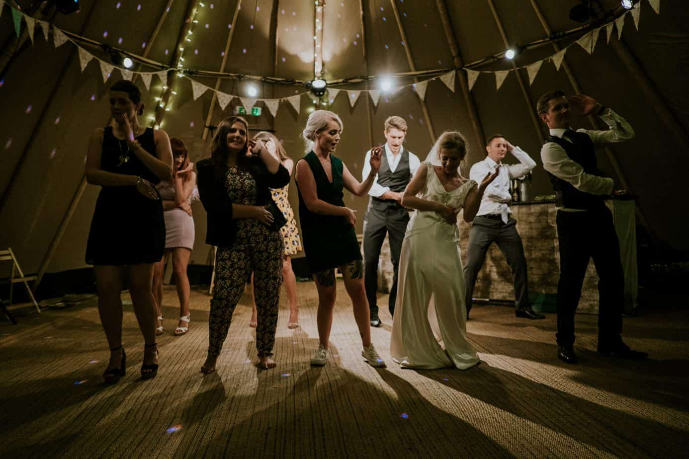 Group of people at a wedding dancing